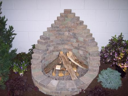 Flower patio show 2009 fire pit progressive lawnscaping for Flower fire pit