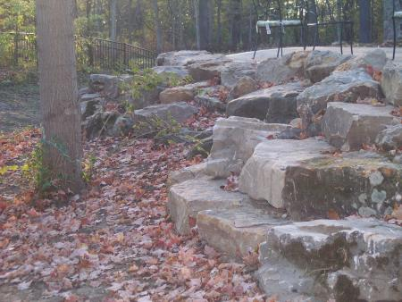 'Green County' Boulder Wall Used For Retaining, Steps and Seating